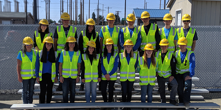 Group of Energy Pathways students in safety gear smiling