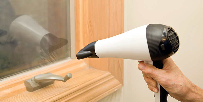 Heat Shrinking Plastic Window Film Insulation with a Hair Dryer