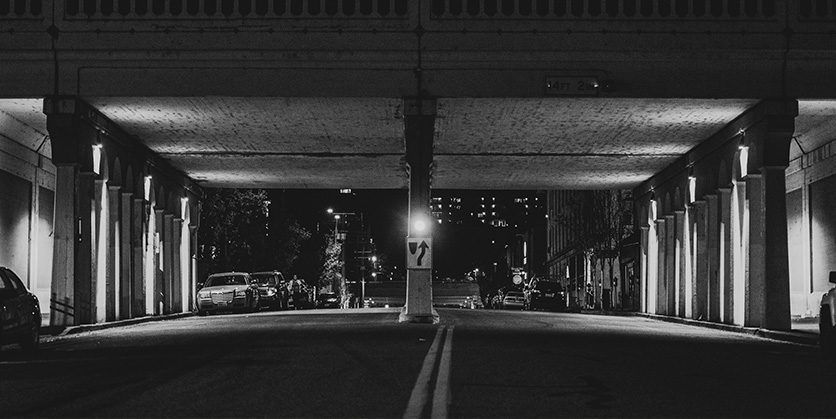 Black and white photo of a bridge in downtown, Spokane, and the street
