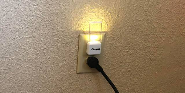 Small night light plugged into a wall