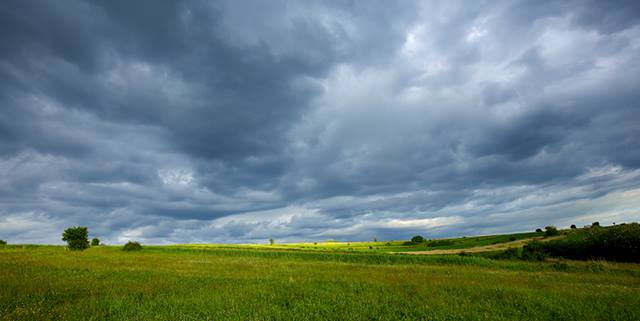 Stormy clouds over a field