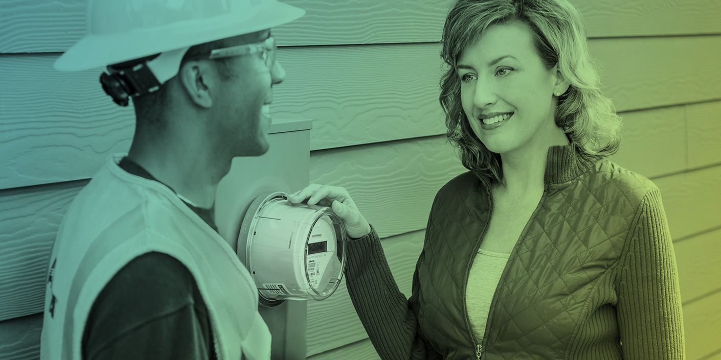 Woman smiling by smart meter