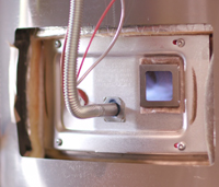 Gas flame seen inside equipment