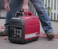 Man starting gas generator