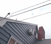 Overhead power lines connecting to house