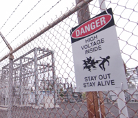 Chain link fence with Danger sign