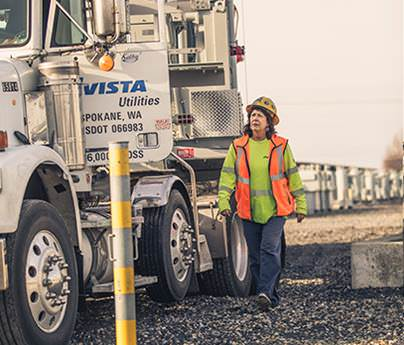 Woman walking towards oversized load truck