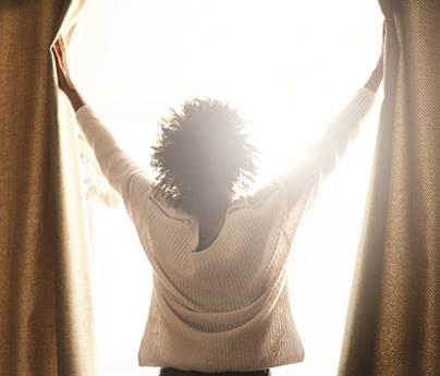 Women opening curtains